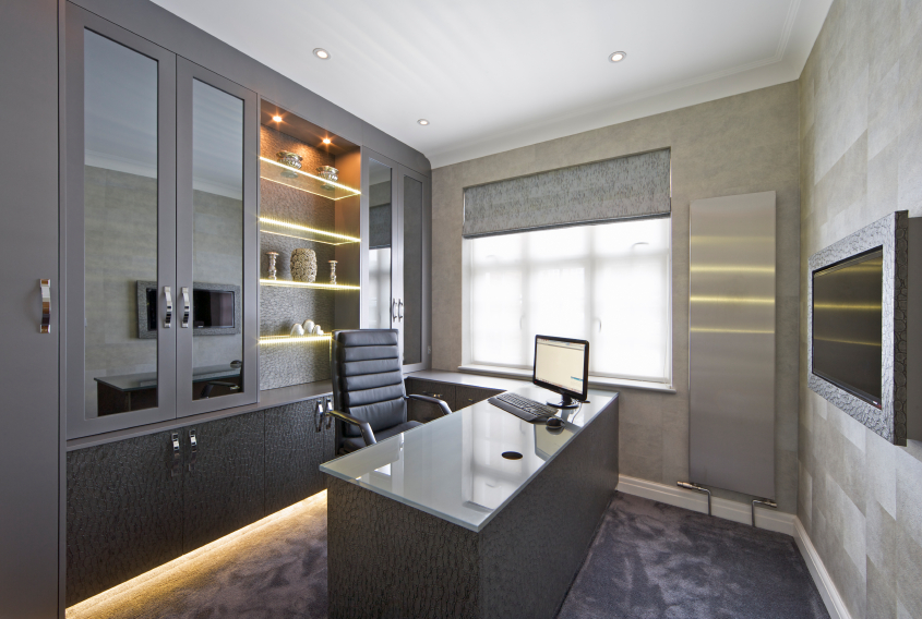 this home office features a distinctly ultra modern look with stainless steel glass bespoke office desks