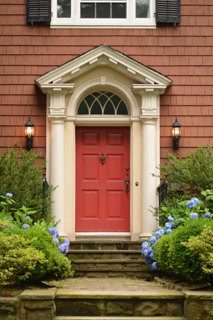 The stone walkway and steps leading up to the bold red front door are lined with & 35 Different Red Front Doors (Many Designs \u0026 Pictures)