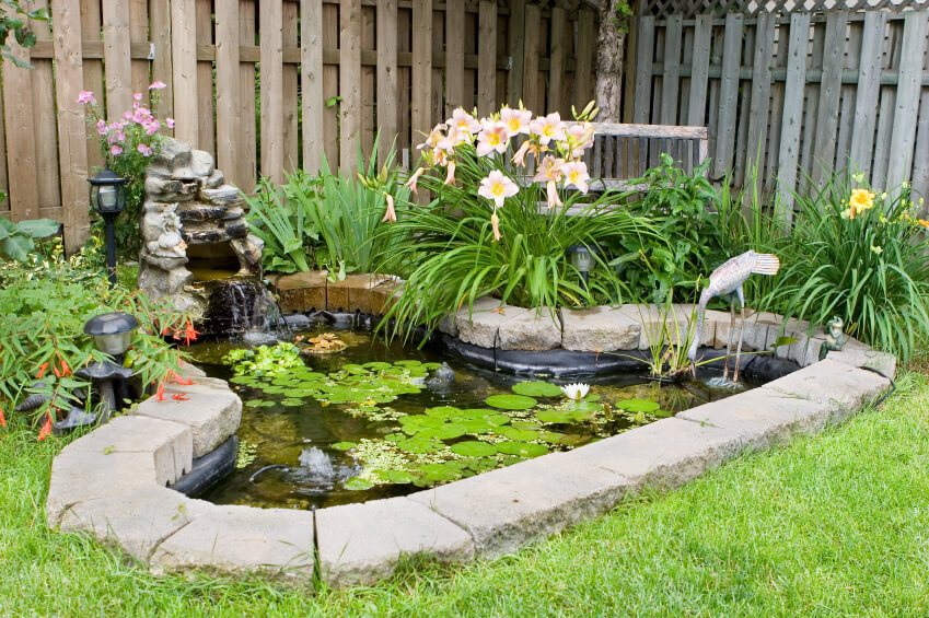 A Simple Pond Edged With Stone Bricks. At The Head Of The Pond Is A