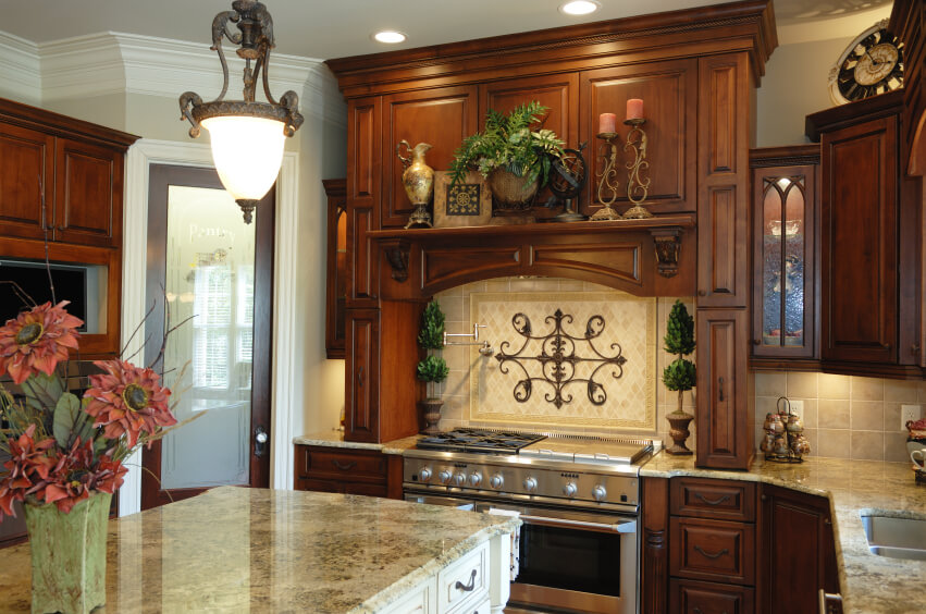 kitchen with light marble countertops and a beige stone backsplash