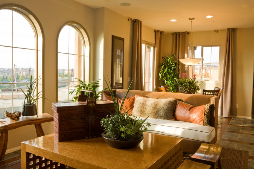 a tile living room with a natural fiber rug and lovely arched windows a carved beautiful small livingroom
