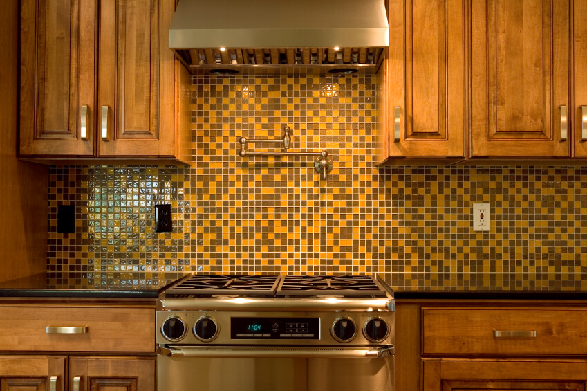 superb Mosaic Tile Designs For Kitchens #7: A retro backsplash in mustard and chocolate brown glass 1 inch mosaic tiles.