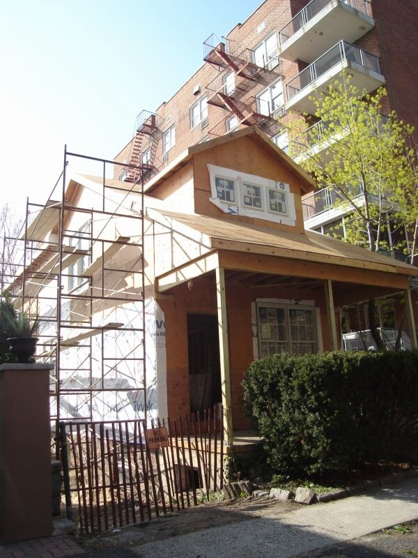 Next, the new windows go in and scaffolding goes up to that the roof and siding can be installed.