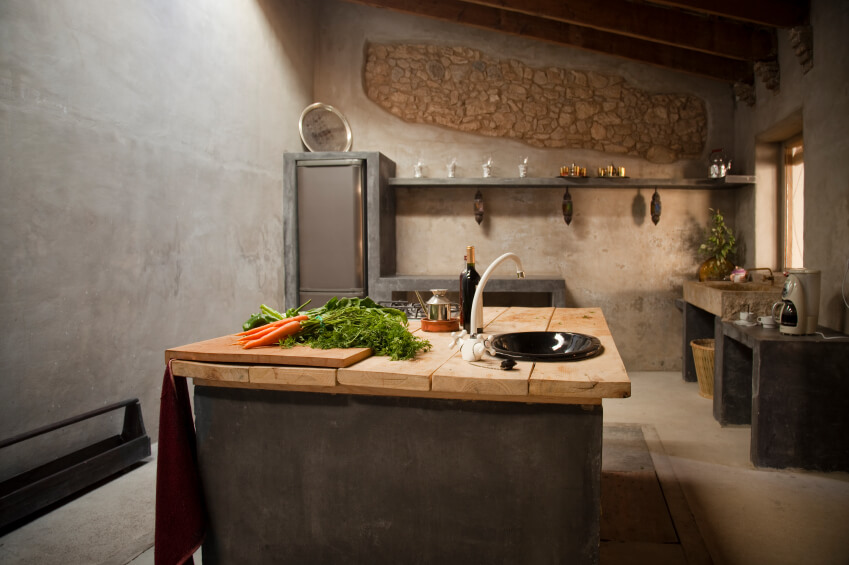 A Rustic Country Kitchen That Looks As Though It Were Carved Completely From Stone The