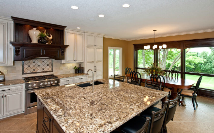 kitchen with an adjacent dining room the busy brown and cream granite