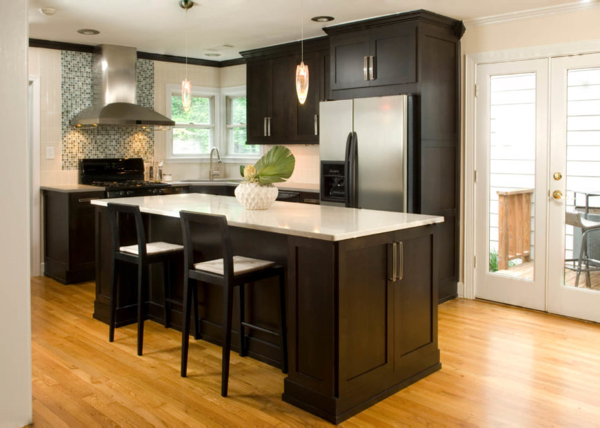 awesome Small Kitchen Remodel With Island #9: A small black and white kitchen with light hardwood oak flooring and a  glass-tile
