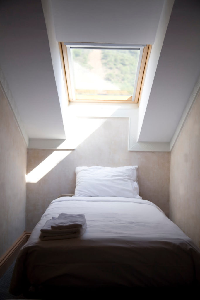 A Sleeping Area Tucked Neatly Into This Attic Nook With A Large Skylight  Illuminating The Space
