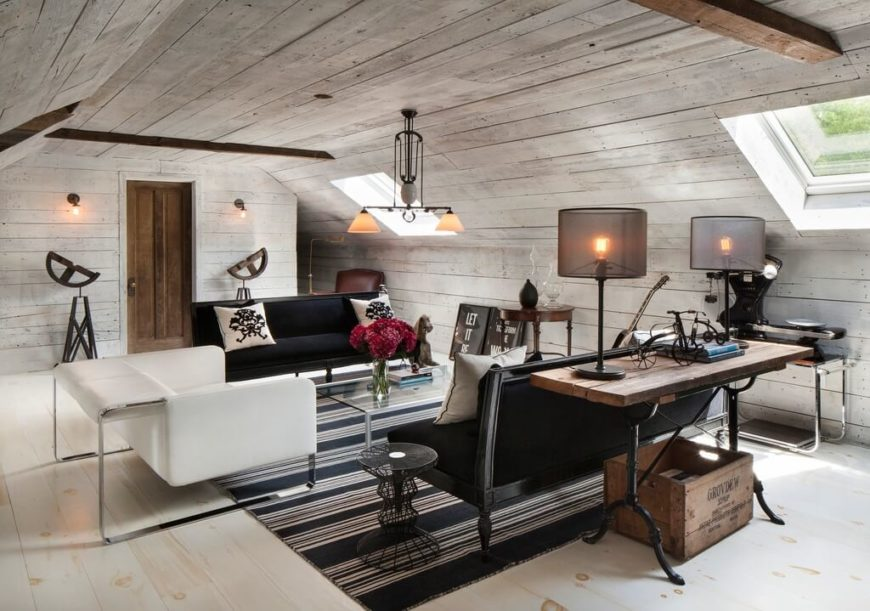 An Attic Used As A Family Room. This White And Black Space Has Both Modern