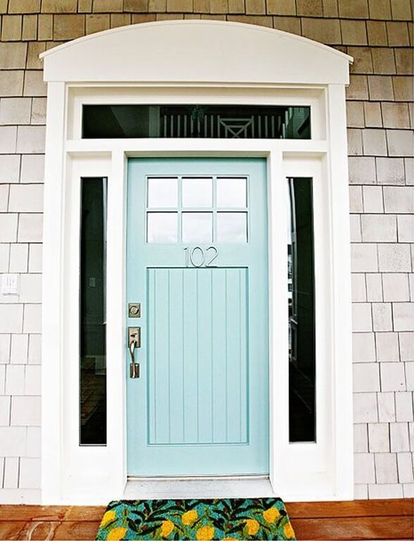 a wooden powder blue front door with glass panels on either side the door has - Front Door Designs For Homes