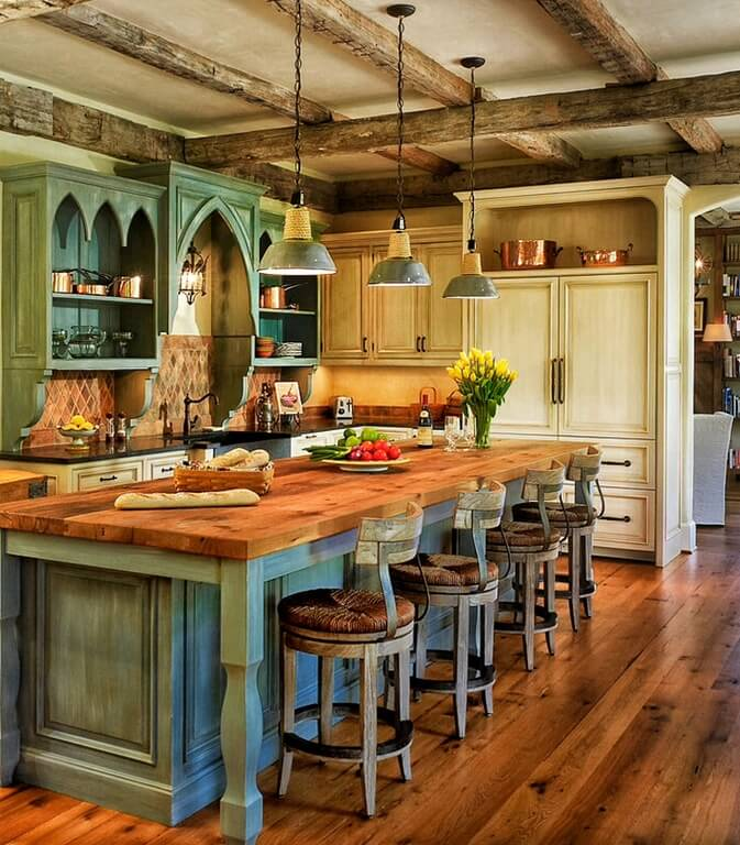 of the kitchen island, which has four barstools with wicker seats