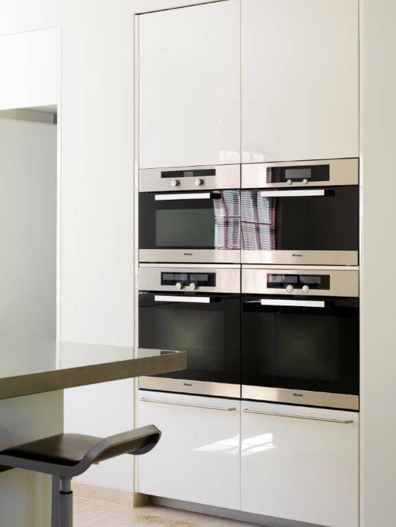This kitchen is modestly sized, but is built to get some serious cooking done, with four convection ovens and two warming drawers.
