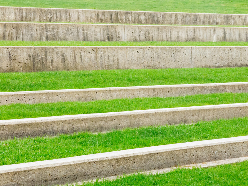 Series of small concrete terraces create steps along this hillside