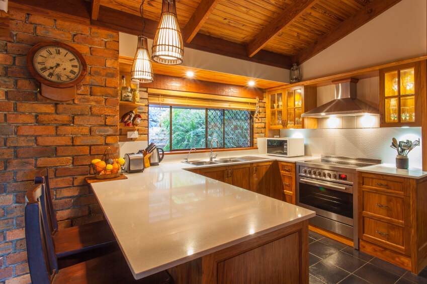 A Brick And Wood Country Kitchen With Bird Cage Like Light Fixtures Above  The Eat Part 92