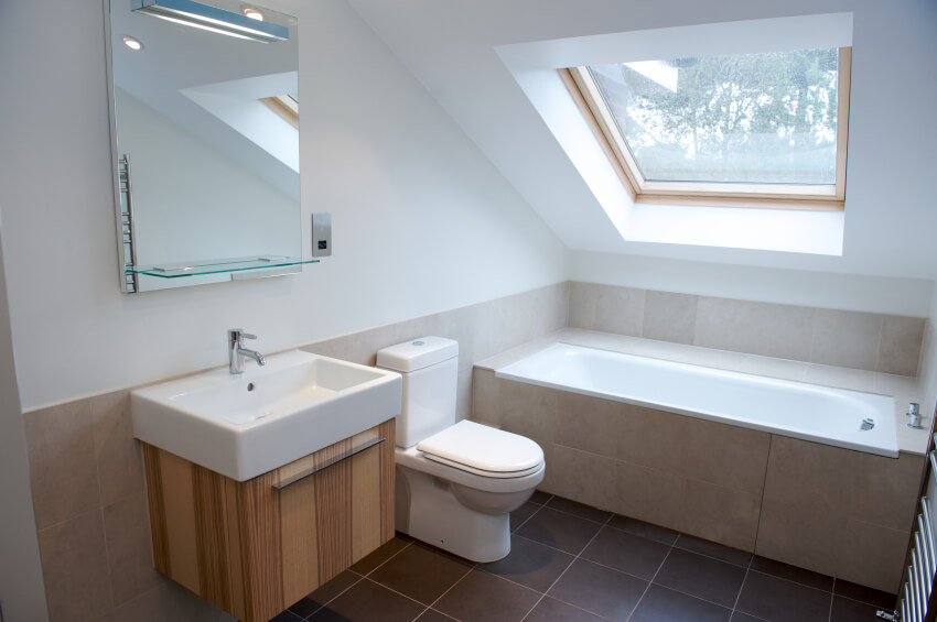 Small Loft Bathroom Ideas Part - 22: A Minimalist Attic Bathroom With A Natural Wood Vanity And A Tile-enclosed  Soaking Tub
