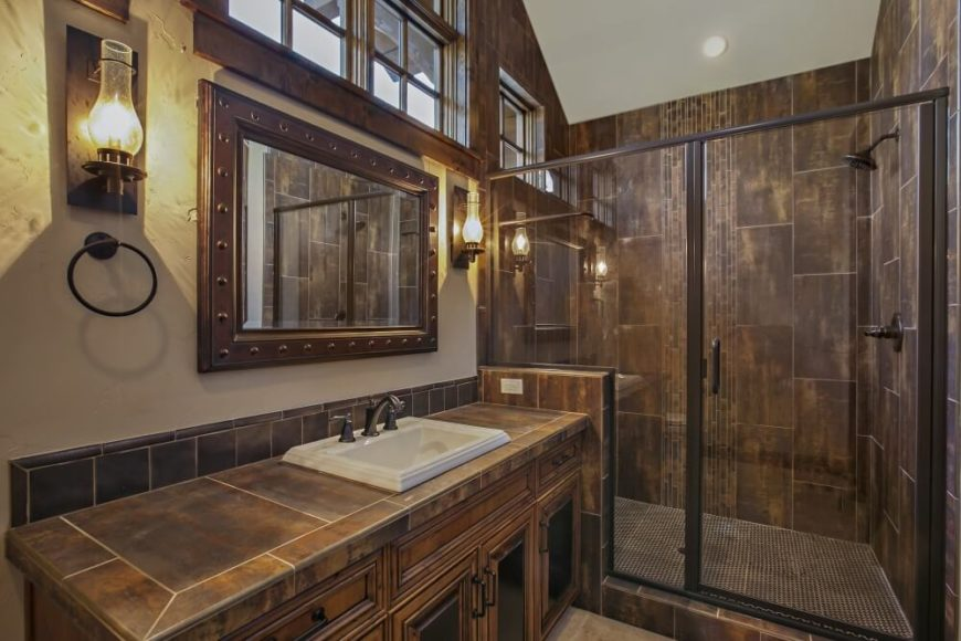 Grand contemporary rustic craftsman home design and floorplan for Rustic tile bathroom ideas