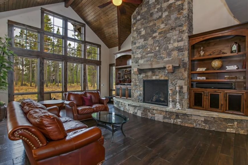 The Grand Room Of This Home Has A Massive Built In Stone Fireplace With A