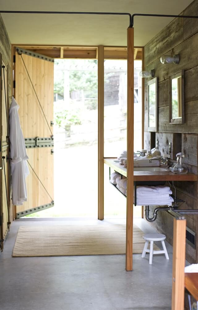One Of The Bathrooms In Barn With Concrete Flooring And A Vanity Towel