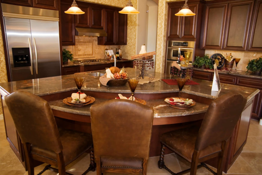 A Luxurious And Modestly Sized Kitchen With A Lower Level Of The Island For Dining