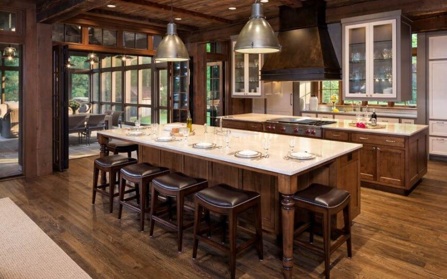 A Rustic Country Home With Gray Glass Front Wall Cabinets Above The Centered Island