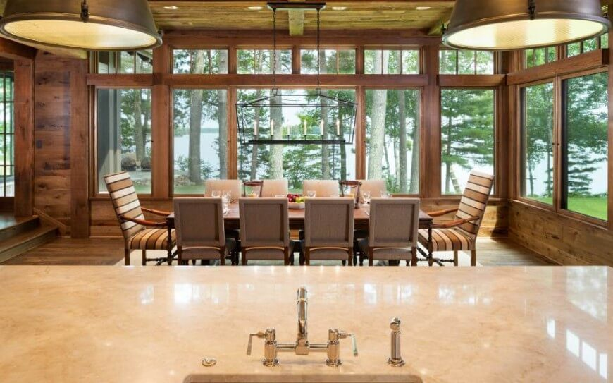 This Cabin Style Home Has Extensive Woodwork Throughout Including In The Dining Room