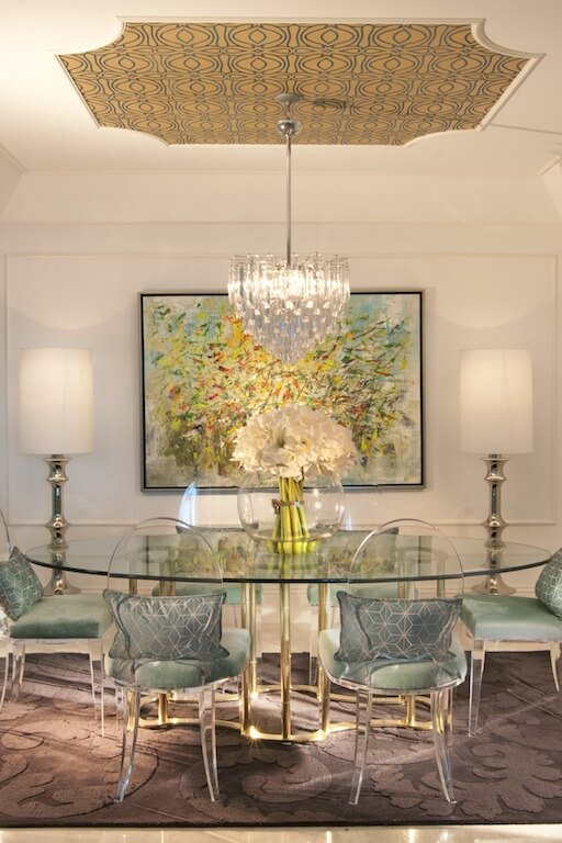 This Throwback To Old Hollywood Glamor Has A Gilt And Glass Dining Table  With Transparent Chairs