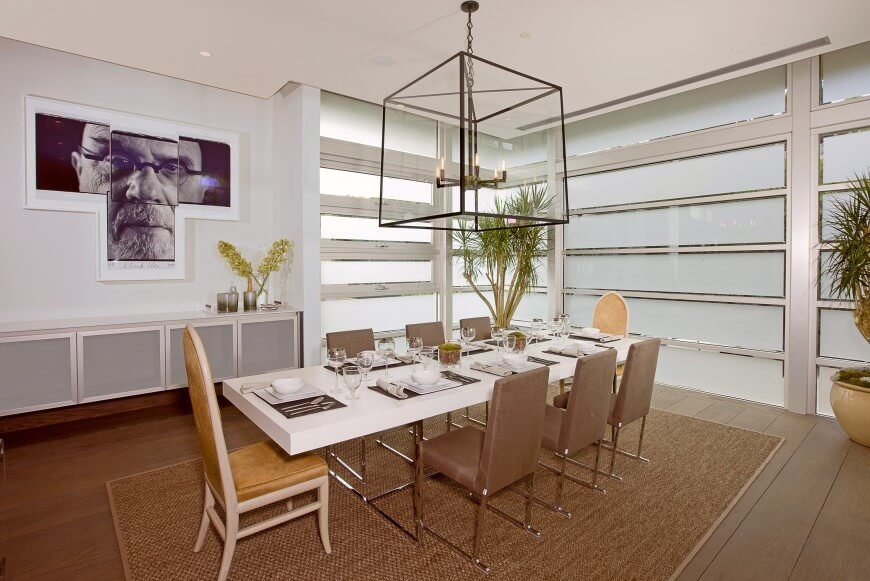 this clean and simple dining room combines modern materials with organic accents like the potted - Simple Dining Room