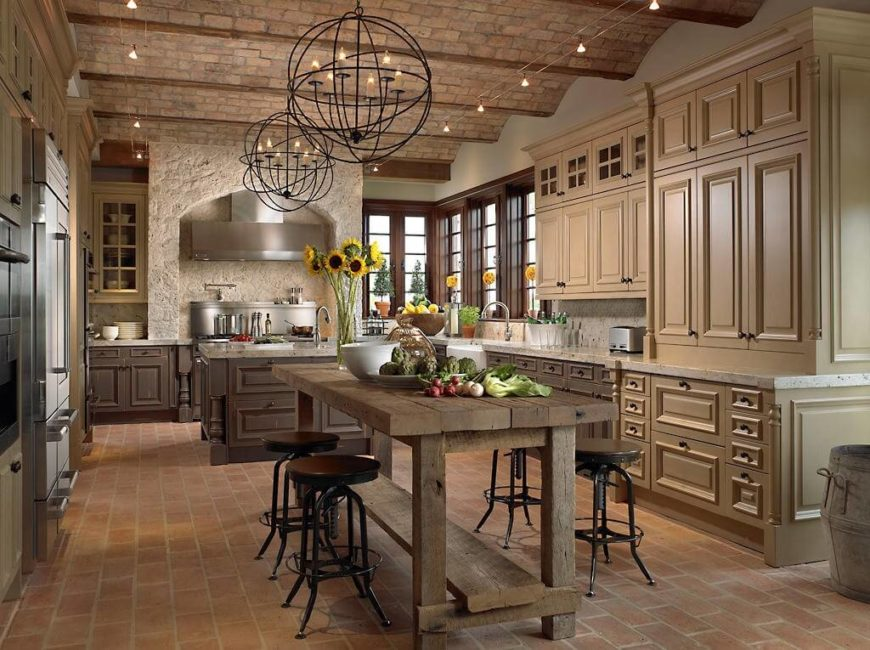 A French Country Kitchen With An Imposing Stone Enclosure Around The Stove The Cabinets Are
