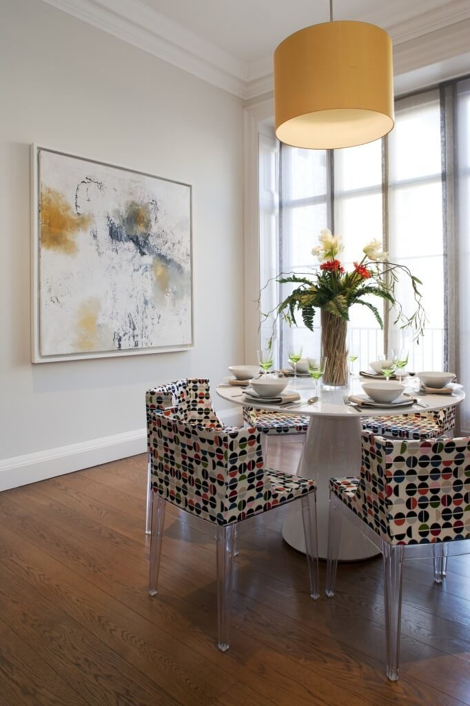 the transparent plastic legs of these low back dining chairs are paired with the bold - Low Dining Room Table