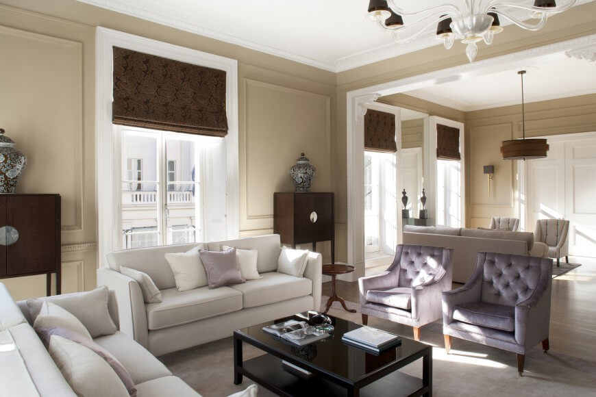 An Elegant Living Room Separated Into Two Distinct Seating Areas With Similar Layouts This Main