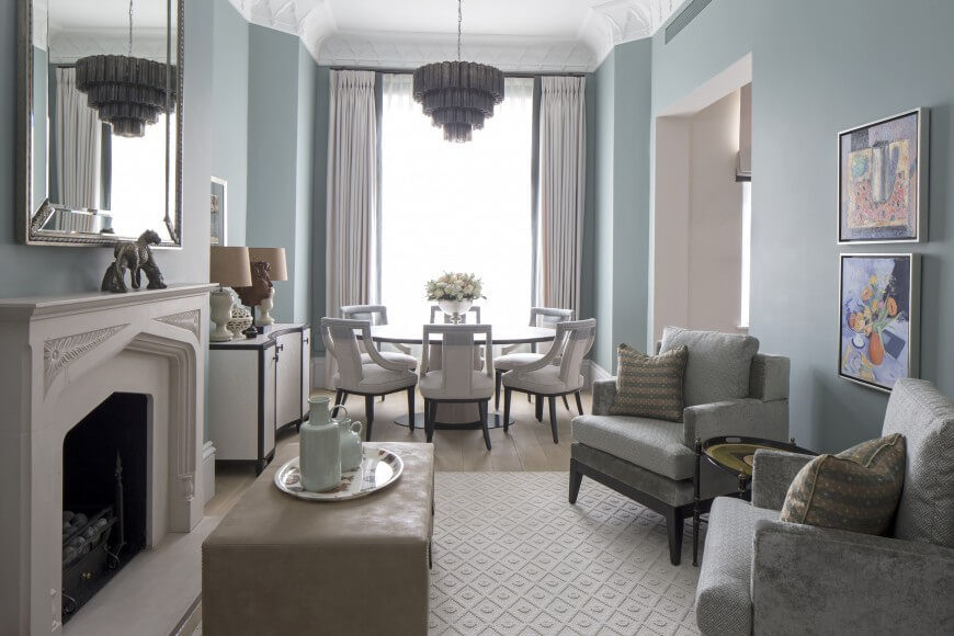 A Small Formal Second Living Room Across From The Large Round Dining Table Two Plush