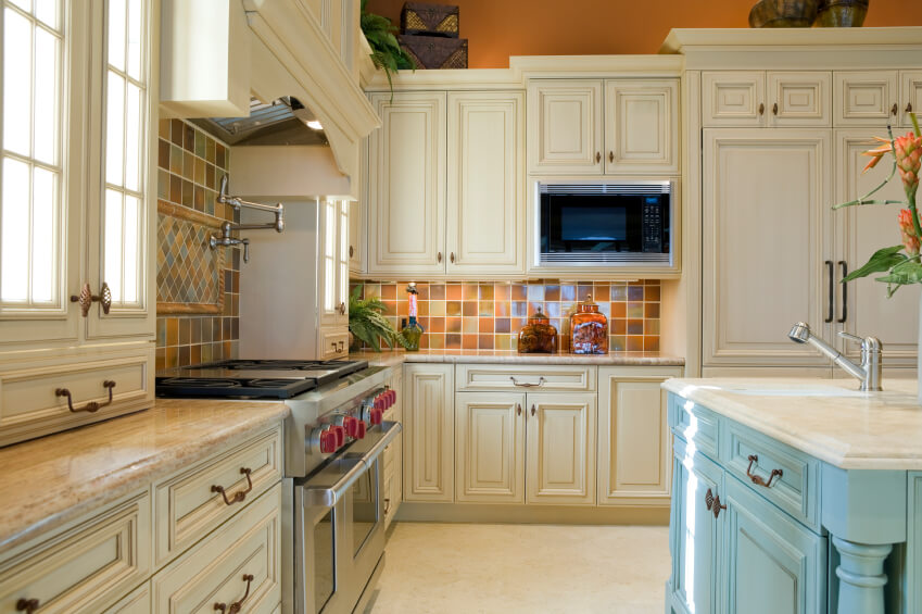 Wonderful A Country Kitchen With A Light Blue Island And Multicolored Ceramic Tiles  For The Backsplash.