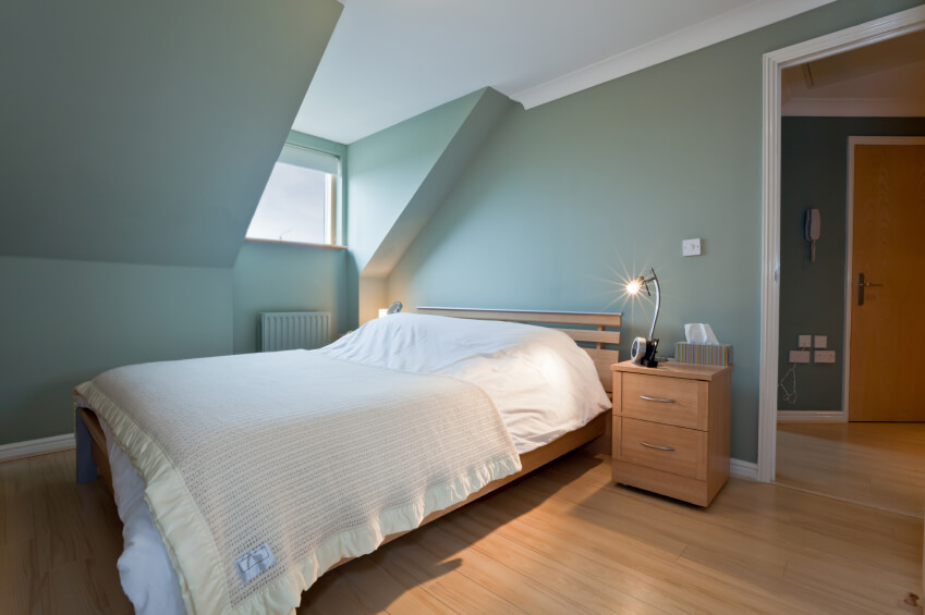 attic furniture ideas. a soft blue wall color is complemented by delicately striped bed linens large window attic furniture ideas e