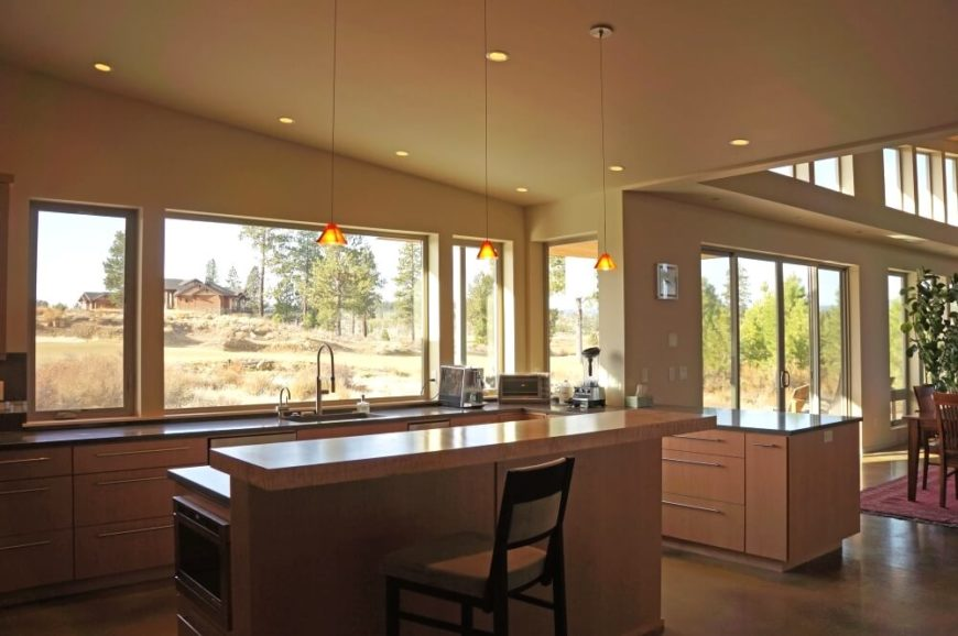 Contemporary rambling prairie style home design with floorplan for Kitchen designs with lots of windows