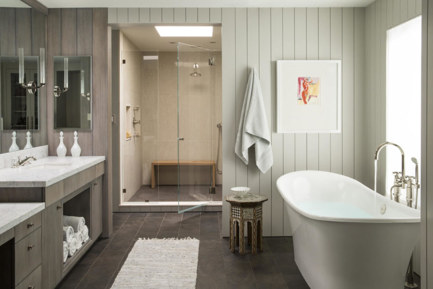 The primary bathroom is separated into masculine and feminine sides a little more obviously than other rooms in the home. This is the feminine side, with the glass-enclosed shower and Albert and Victoria soaking tub.