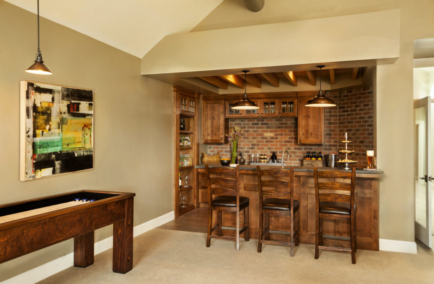 Behind The Main Television Watching Area Is The Home Bar And A Game Table.  The