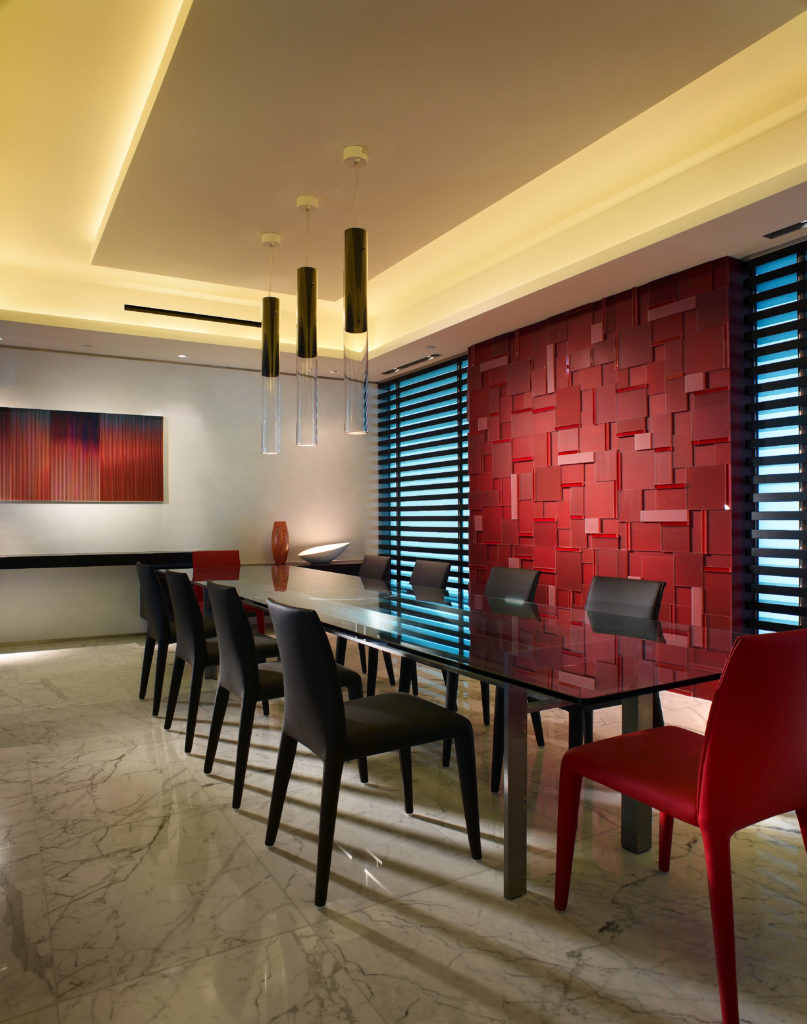 The layered red rectangle look of the archway is repeated on the accent wall behind the
