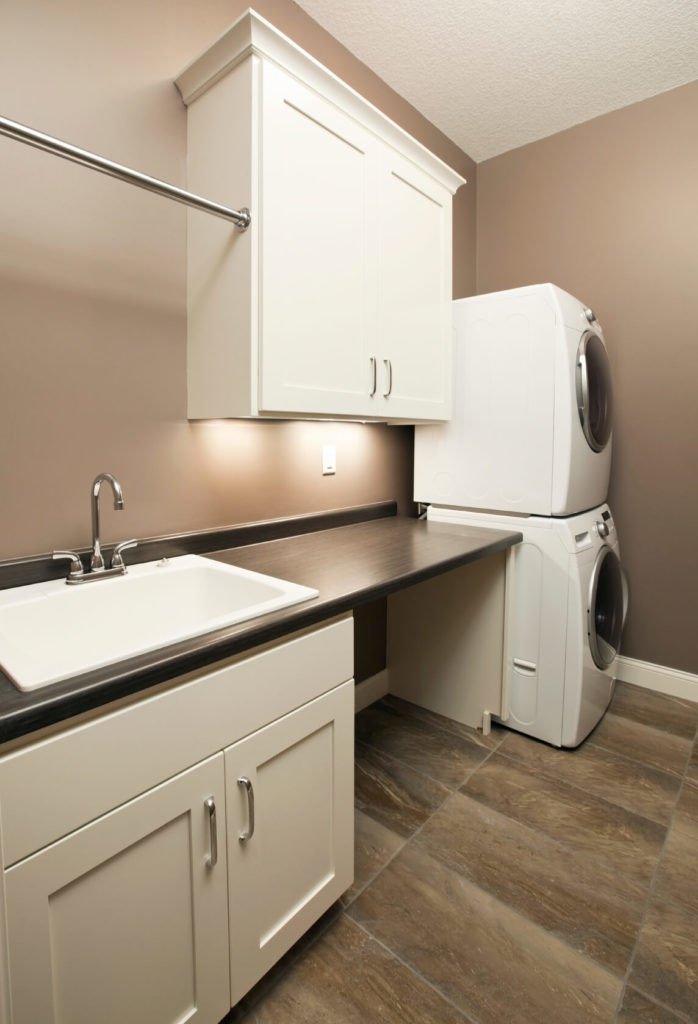 Small Sink For Laundry Room : small laundry room with stacked appliances and an open space beneath ...