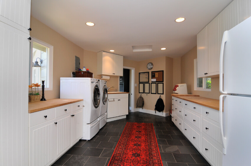 combination mudroom and laundry room with charcoal tile flooring and