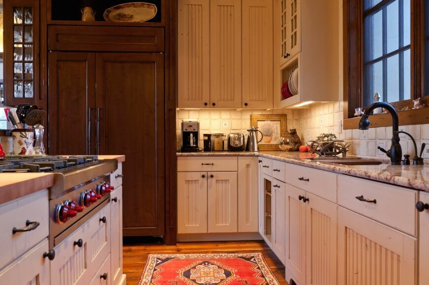 Smaller Country Kitchen With Light Granite Countertops In Beige And
