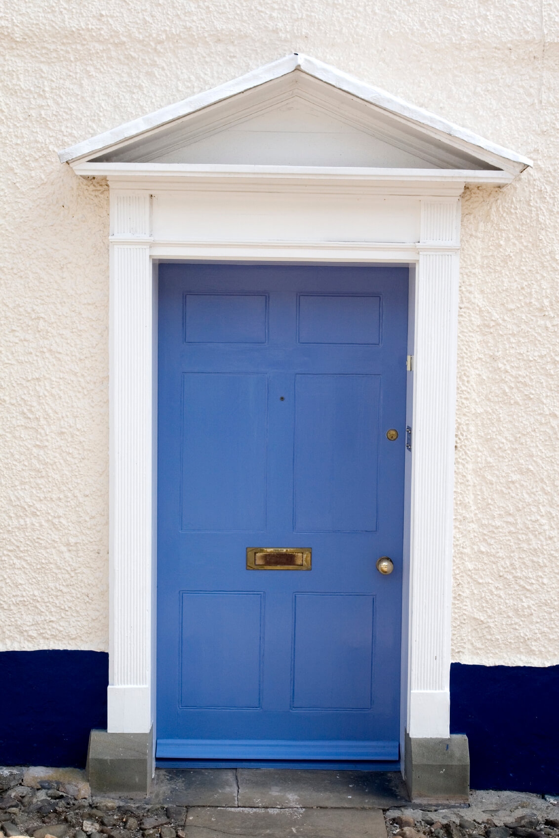 Dark blue front doors - A Blue Front Door Situated On A Front Exterior Wall Of Concrete Which Is Painted White