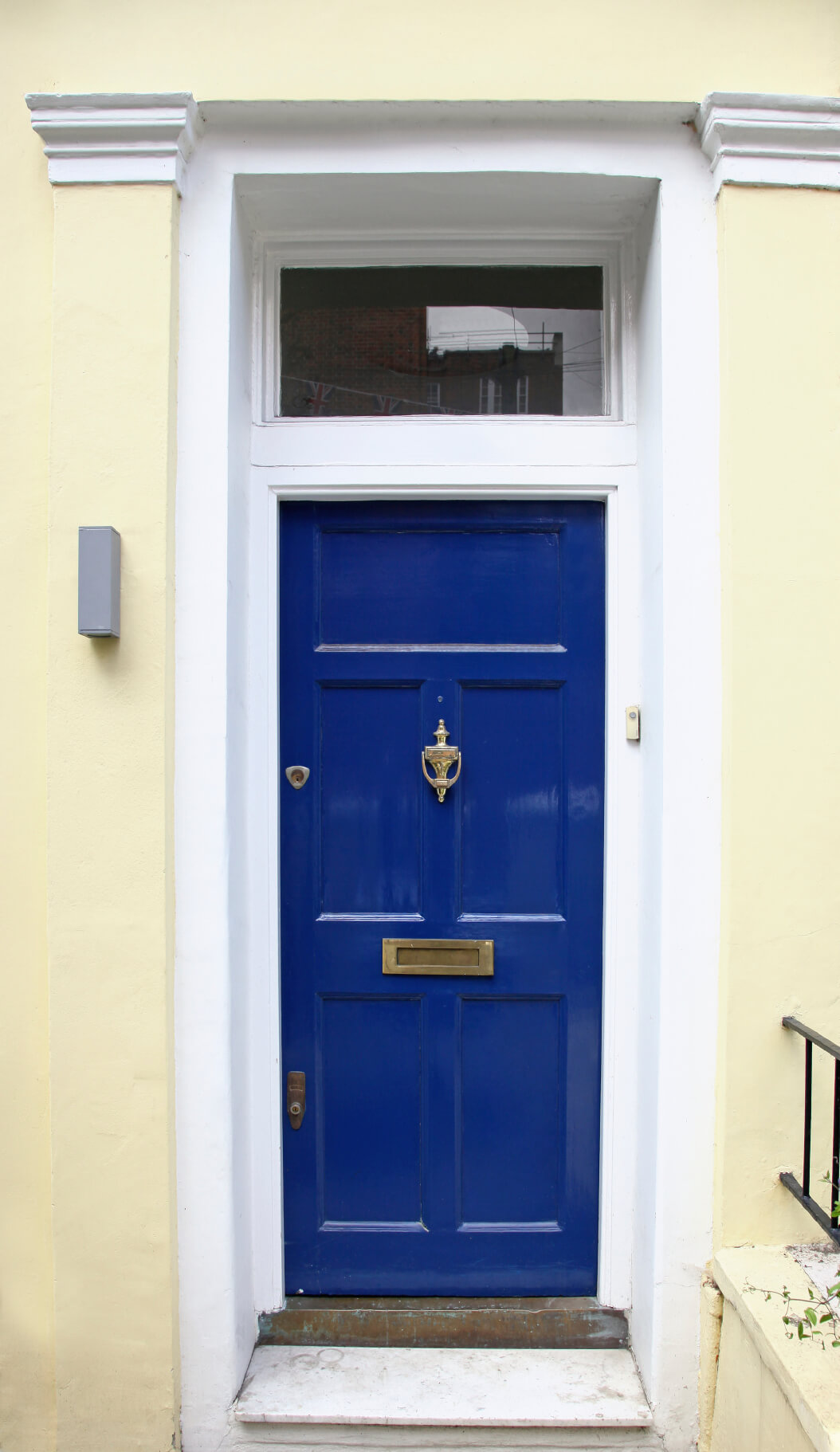 21 cool blue front doors for residential homes this home has a concrete facade that has been painted beige it has a blue rubansaba
