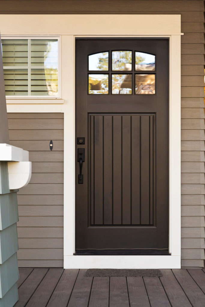 This Black Door Is Highlighted By White Trim On A Neutral Grey Toned Home.  Simple