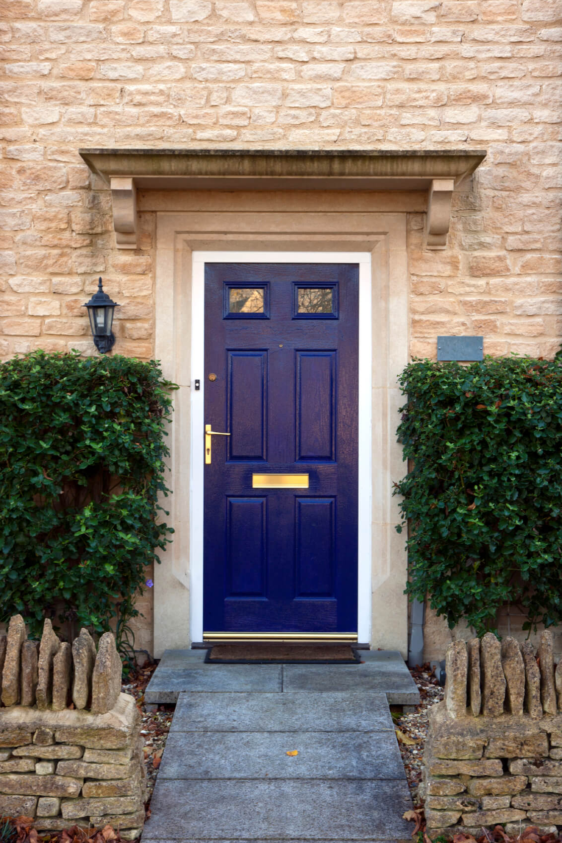 This Home Has A Stone Front Exterior. It Has A Blue Wooden Door With Glass