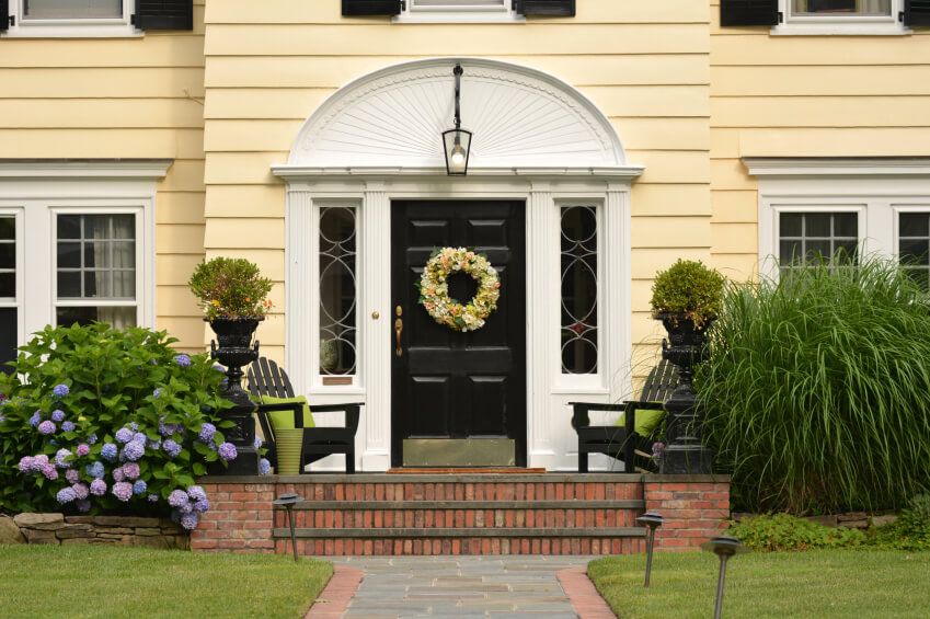 Yellow traditional home with a black front door & 27 Pictures of Black Front Doors (Front Entry)