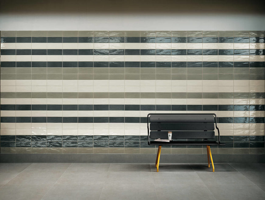 The easy-to-clean subway tiles in this metro station are in stripes of taupe, black, and white. The tiles add a bit of flair and style, but are still easily taken care of and are not damaged easily. Perfect for a public place.