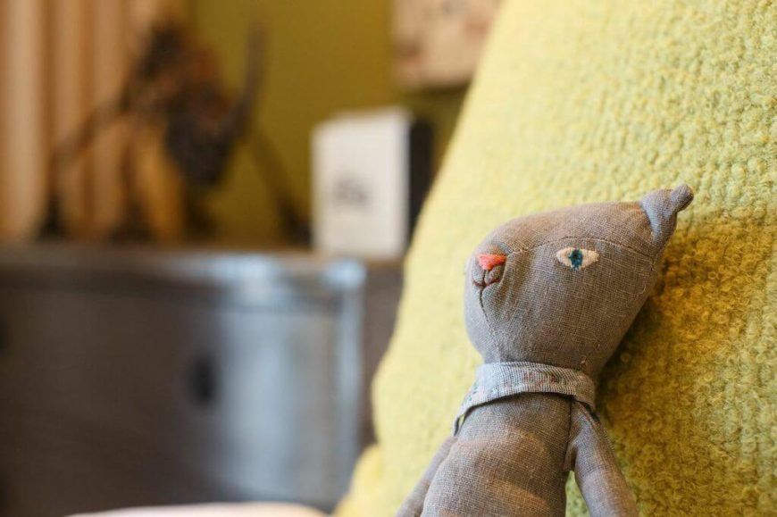 A close-up of the linen teddy bear, which has been made to look like a vintage stuffed animal.