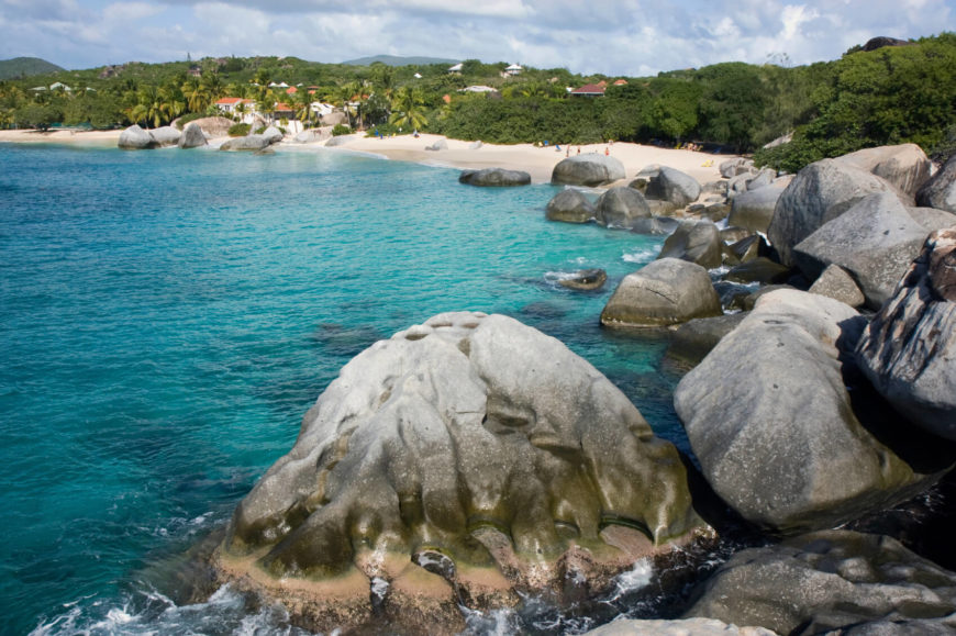 "A view of one of the many beaches of Virgin Gorda, near the large water-weathered rocks of ""The Baths."" The enormous boulders that dot the beach give this white sanded beach a unique look."
