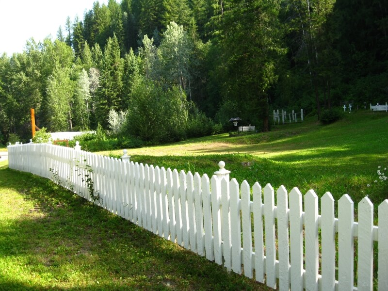A Picket Fence Serving As Perimeter Of Graveyard In The Countryside