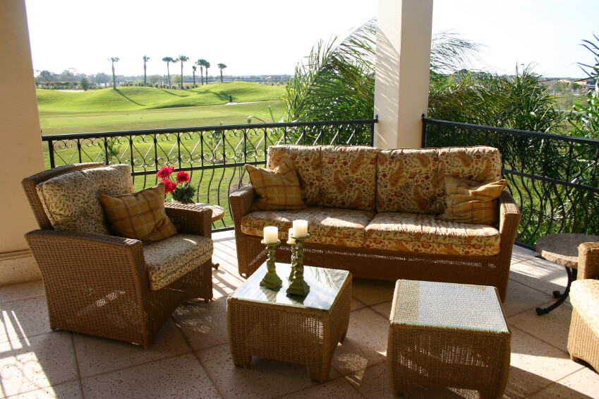 This Pitted Stone Patio Over Looks A Large Golf Course With Some Tall Palms  Off In
