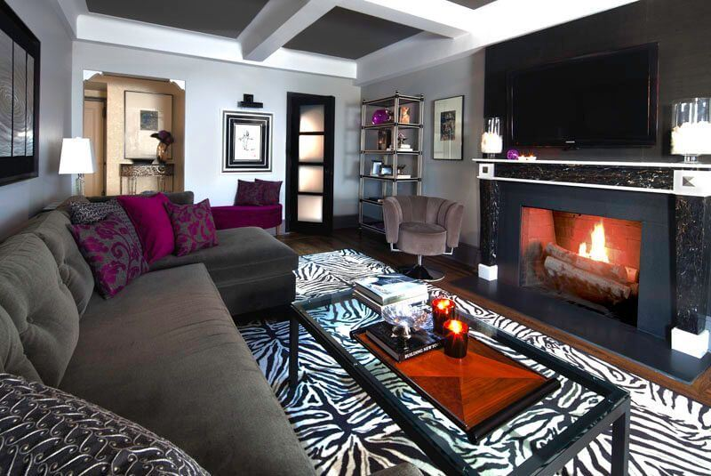 Full view of the living room with coffered ceilings and a large sectional sofa.